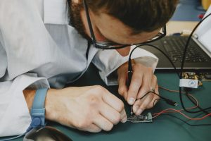 Electronics engineer testing a pcb