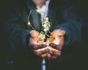 Person holds a lightbulb