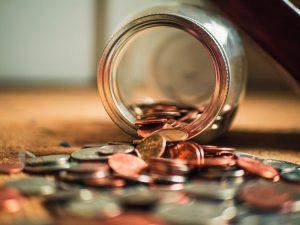 Money spilling out of a pot